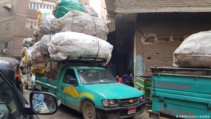 A pickup truck transporting huge sacks of garbage collected in Cairo's streets