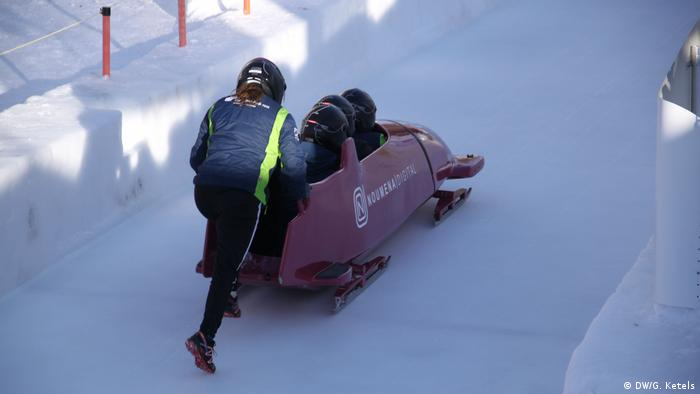 Four-man bobsled on the St. Moritz bob run during a guest ride