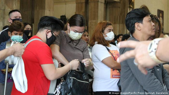 Philippine people wear face masks to protect themselves from coronavirus