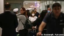 Travellers wearing protective face masks, after the third case of coronavirus in Sao Paulo was confirmed, at Guarulhos International Airport in Guarulhos, Sao Paulo state, Brazil, March 5, 2020. REUTERS/Rahel Patrasso