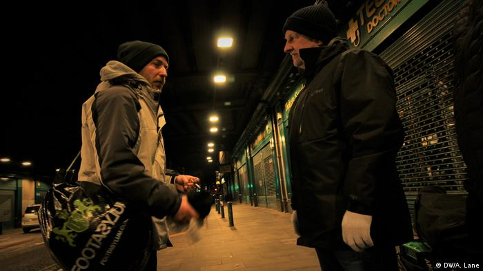A homeless man and an aid volunteer in Glasgow