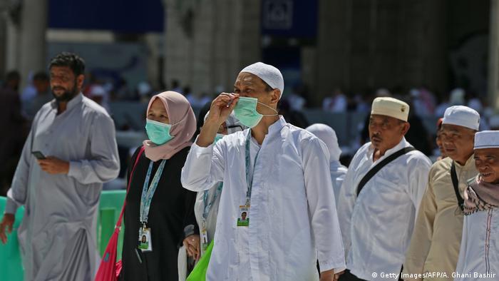 Pilgrims wearing masks at the Grand Mosque in Mecca, Saudi Arabia