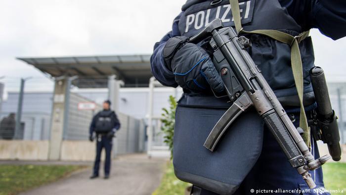 Police outside the higher regional court in Düsseldorf