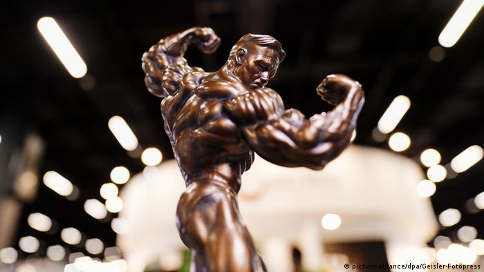 A trophy showing a bronze figure of a bodybuilder