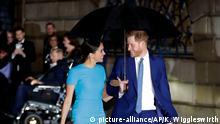 London Prinz Harry und Meghan im Regen