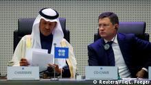 FILE PHOTO: Saudi Arabia's Minister of Energy Prince Abdulaziz bin Salman Al-Saud and Russian Energy Minister Alexander Novak at the start of an OPEC and NON-OPEC meeting in Vienna, Austria, December 6, 2019. REUTERS/Leonhard Foeger/File Photo