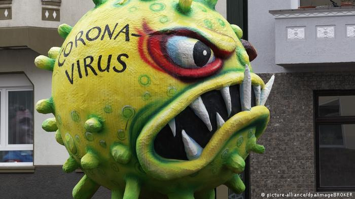 An ugly coronavirus caricature displayed at a carnival procession in Düsseldorf, Germany