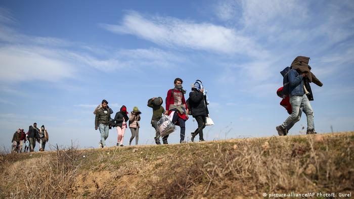 Migrants walk near Edirne at the Turkish-Greek border.