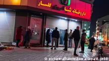 February 29, 2020, Rasht, Iran: People wait to purchase health items at a pharmacy..After the spread of the Coronavirus in Iran, people have been restricted to the streets so people leave their homes only for essential purchases and health items. The military and fire forces decided to disinfect every passage and city every night. (Credit Image: © Babak Jeddi/SOPA Images via ZUMA Wire |