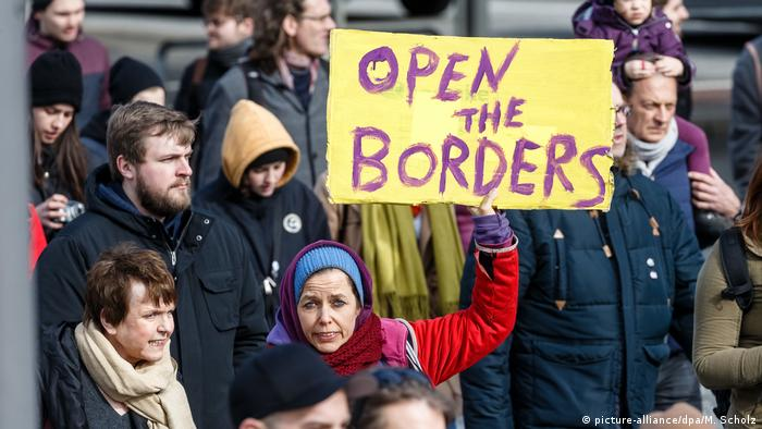 Protesters in Hamburg with a sign reading Open the borders