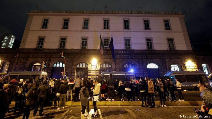 Relatives of inmates gather outside Poggioreale prison in Naples, Italy