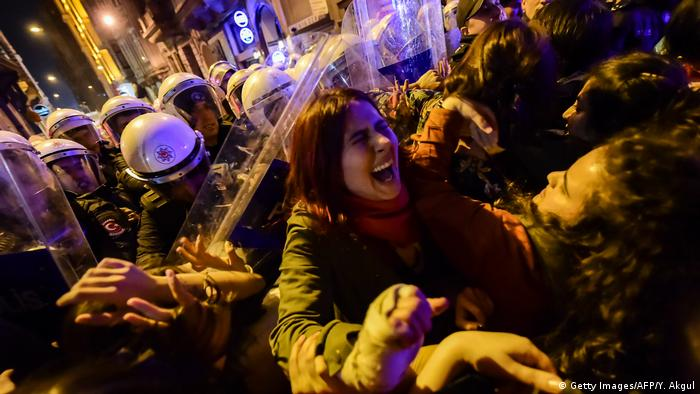 A woman in Istanbul is beated by police