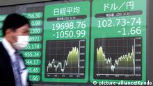 09.03.2020 A financial data screen in Tokyo shows the 225-issue Nikkei Stock Average closing at a 14-month low below the 20,000 line and the U.S. dollar falling to the upper 102 yen level amid escalating coronavirus fears on March 9, 2020. (Kyodo) |