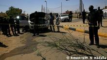 Security personnel stand near a car damaged after an explosion targeting the motorcade of Sudan's Prime Minister Abdalla Hamdok near the Kober Bridge in Khartoum, Sudan March 9, 2020. REUTERS/Mohamed Nureldin Abdalla