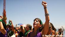 A member of a women's collective gestures while she sings the song The rapist is you, that became famous in Chile, marking the International Women's Day in Rio de Janeiro, Brazil, March 8, 2020. REUTERS/Pilar Olivares