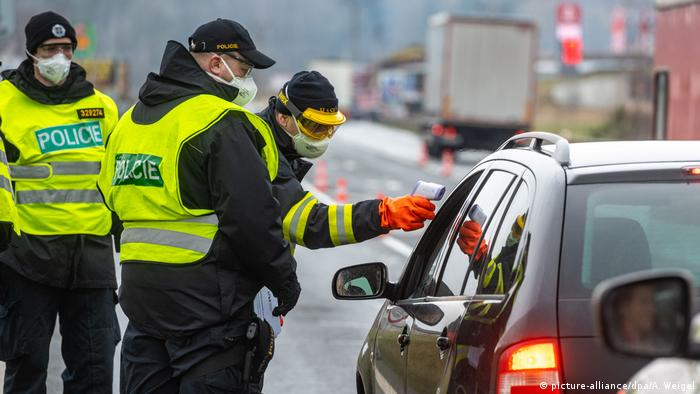 Border authorities check the temperature of a traveler in the Czech Republic