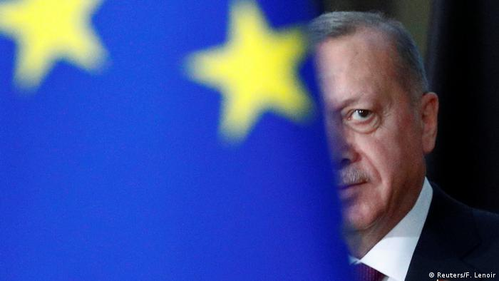 Erdogan peers around blue EU flag