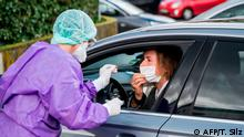 Roxana Sauer, Medical Director of the Medical Care Centre (MVZ) takes a sample for a COVID-19 coronavirus test on a fictional patient in her car at a drive-through testing centre on March 9, 2020 in Gross-Gerau. (Photo by Torsten Silz / AFP)