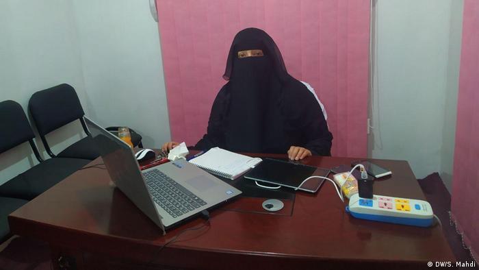 A psychiatrist in Yemen at her desk