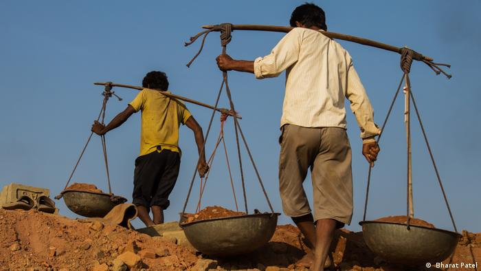 Modern slavery. Men toiling in a mine