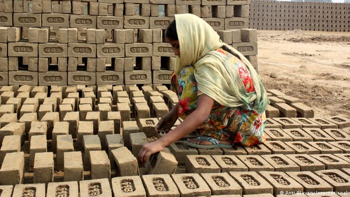 Millions held in debt bondage. Here a worker in a brick factory