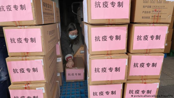 A woman sorts medical supplies in Nantong,Jiangsu,China