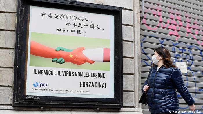 A sign in Milan showing Chinese and Italian hands shaking