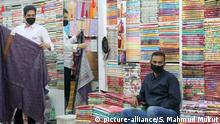 March 10, 2020, Dhaka, Bangladesh: Salesmen at a shopping mall wear protective masks as a preventive measure against the spread of Coronavirus in Dhaka..Authorities in Bangladesh have confirmed first three patients of Covid-19, a new strain of coronavirus that has killed over 3,600 people around the world. The Institute of Epidemiology Disease Control and Research (IEDCR) confirmed that three other people, who were in close contact with the infected trio, have also been quarantined. (Credit Image: © Sultan Mahmud Mukut/SOPA Images via ZUMA Wire |