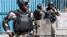 The police secure the area in front of the office of immigration and emigration after protesters tried to burn it during a demonstration demanding the resignation of President Jovenel Moise in the Haitian capital in Port-au-Prince on October 28, 2019. - Over the past year, Haiti has sunk deeper into political crisis amid anti-corruption protests demanding President Jovenel Moise's resignation. (Photo by Valerie Baeriswyl / AFP) (Photo by VALERIE BAERISWYL/AFP via Getty Images)