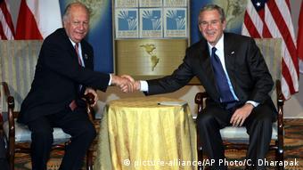Lagos junto al presidente de Estados Unidos, George Bush, en 2005.