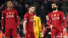Liverpool's Egyptian midfielder Mohamed Salah (R) reacts at the final whistle during the UEFA Champions league Round of 16 second leg football match between Liverpool and Atletico Madrid at Anfield in Liverpool, north west England on March 11, 2020. (Photo by Paul ELLIS / AFP)