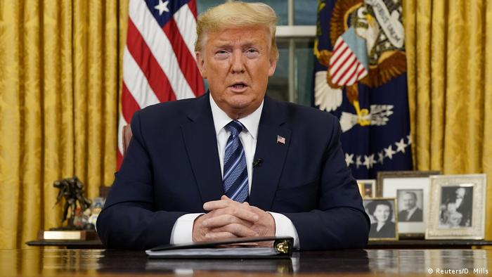 US President Donald Trump speaks from the Oval Office of the White House.