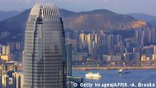 This general view from The Peak shows Hong Kong's latest addition to its skyline, the newly completed 88-storey Two IFC building (C), towering above the city, 12 July 2003. Two IFC, which is the third tallest building in the world behind the Sears Tower in Chicago and the Petronas Towers in Kuala Lumpur, is expected to open for business in a month. AFP PHOTO/Richard A. BROOKS (Photo credit should read RICHARD A. BROOKS/AFP via Getty Images)