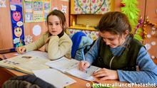 9.1.2019, Ukraine, Schoolgirls sit at a desk in a classroom at a school situated in the 19th-century Myklashevskyi Manor, Bilenke village, Zaporizhzhia Region, southeastern Ukraine, January 9, 2019. Ukrinform. |