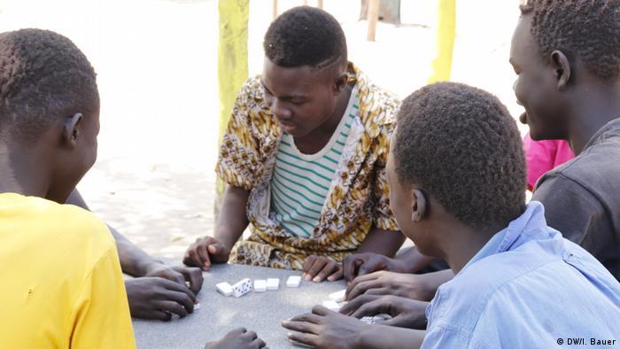 Former UNRF II rebels playing a board game
