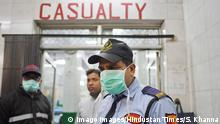 NEW DELHI, INDIA - MARCH 11: Security personnel seen wearing protective masks outside the casualty ward for Coronavirus affected patients inside Hindu Rao Hospital, at Civil Lines on March 11, 2020 in New Delhi, India. Photo by Sanchit Khanna/Hindustan Times People Take Precautionary Measure Against The Spread Of Coronavirus In India PUBLICATIONxNOTxINxIND