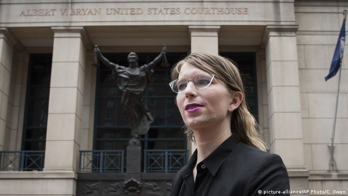 Chelsea Manning in front of a court house