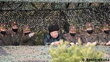 North Korea leader Kim Jong Un observes an artillery fire competition between the artillery units under the Korean People's Army Corps 7 and Corps 9 at a training ground in North Korea, March 12, 2020 in this picture supplied by North Korea's Korean Central News Agency (KCNA) . KCNA via REUTERS ATTENTION EDITORS - THIS IMAGE WAS PROVIDED BY A THIRD PARTY. REUTERS IS UNABLE TO INDEPENDENTLY VERIFY THIS IMAGE. NO THIRD PARTY SALES. SOUTH KOREA OUT. NO COMMERCIAL OR EDITORIAL SALES IN SOUTH KOREA. TPX IMAGES OF THE DAY