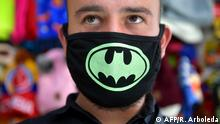 A man uses a face mask as a precautionary measure in the face of the global COVID-19 coronavirus pandemic, in Bogota on March 12, 2020. - Colombia declared on March 12, 2020 a Health Emergency due to the new coronavirus pandemic, a figure that allows it to take exceptional measures such as prohibiting the disembarkation of cruise ships and the holding of public events with more than 500 attendees. (Photo by Raul ARBOLEDA / AFP)