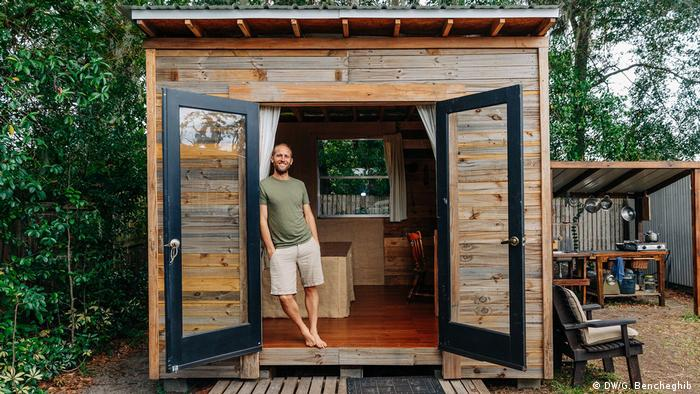 Activist Rob Greenfield poses in his tiny house