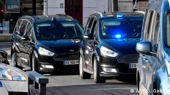 A police escort takes Joel Le Scouarnec, accused of mass child sexu abuse, to trial in western France (AFP/G. Gobet)