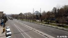 A photograph taken on March 13, 2020 shows an almost emply road in the Iranian capital Tehran, after measures were taken to slow down the spread of the coronavirus COVID-19. - The outbreak of the virus in Iran is one of the deadliest outside China, where the disease originated. Several politicians and officials both sitting and former have been infected, with some dying from the illness. (Photo by STR / AFP)