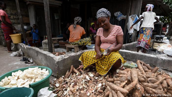 A woman peeling cassava in Abidjan
