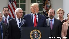 U.S. President Donald Trump declares the coronavirus pandemic a national emergency as Vice President Mike Pence, Health and Human Services Secretary Alex Azar and other officials listen during a news conference in the Rose Garden of the White House in Washington, U.S., March 13, 2020. REUTERS/Jonathan Ernst