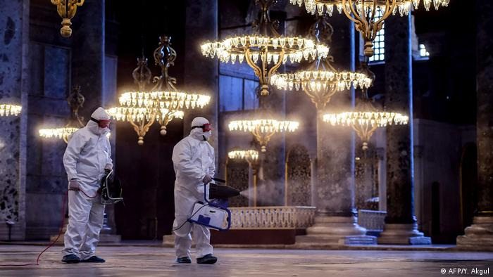 Employees of the Fatih Municipality wearing protective suits disinfects the Hagia Sophia to prevent the spread of the COVID-19, caused by the novel coronavirus, in Istanbul