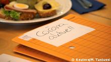 A note on documents reading Corona aktuell lies on the table during a meeting with the economy ministers from Germany's 16 states to discuss the economic impact of coronavirus disease (COVID-19), Berlin, Germany March 10, 2020. REUTERS/Michele Tantussi