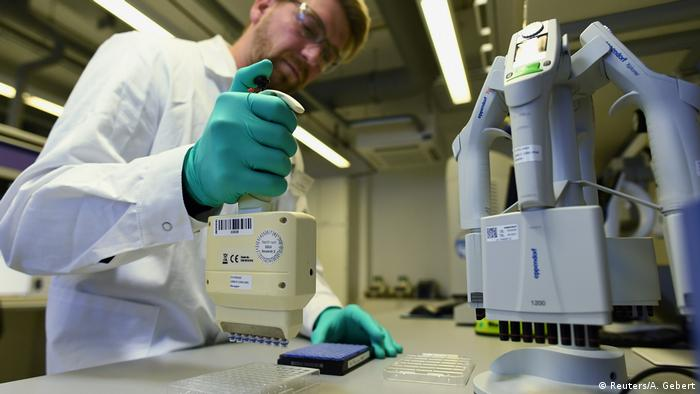 Employee Philipp Hoffmann, of German biopharmaceutical company CureVac, demonstrates research workflow on a vaccine (Reuters/A. Gebert)