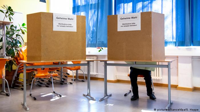 A voter casts their ballot in Bavaria