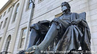 USA John Harvard statue has a mask over its mouth
