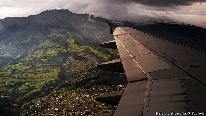 An airplane wing is seen over Quito, Ecuador